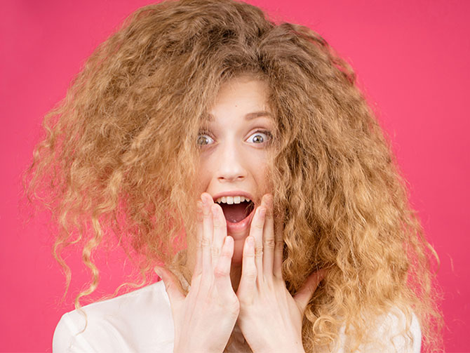 FIGHTING FRIZZY HAIR TOGETHER WITH FRIZZ DEFENSE<sup>®</sup>